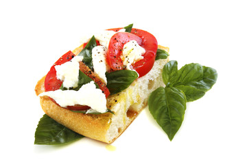 Ciabatta with tomato and cheese.