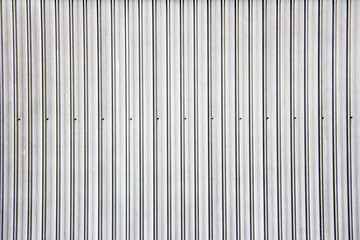 Wide shot of silver corrugated metal wall