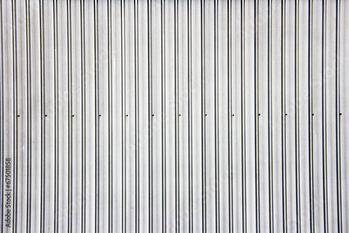 Canvas Metal Wide shot of silver corrugated metal wall