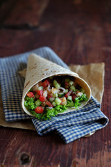 Tortilla wrap with vegetables and seafood