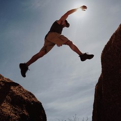 Man jumping between rocks
