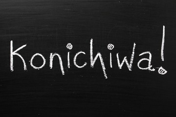 The Japanese word Konichiwa written on a blackboard