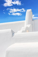 Stylish white chimney against blue sky in Mykonos.NEF