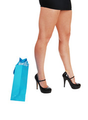 Woman legs wit shopping bag.