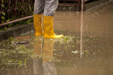 Man standing in a flooded yard
