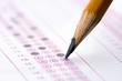 Leinwanddruck Bild - Multiple choice examination form with yellow pencil