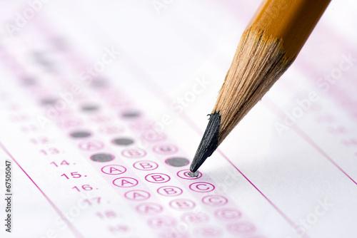 Leinwanddruck Bild Multiple choice examination form with yellow pencil