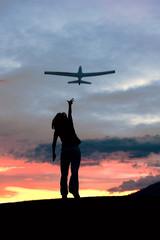 Woman flies tor plane.