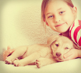 child and puppy