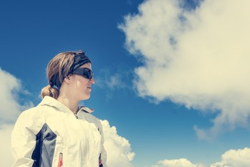 Portrait of a young woman watching clouds