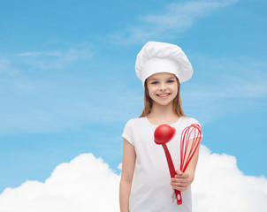 smiling girl in cook hat with ladle and whisk