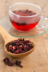 Hibiscus tea on wooden surface