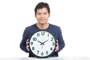 Asian man show a clock and smile