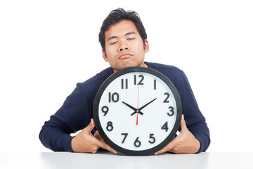Asian man is sleepy with a clock
