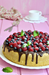 Berry cake with sour cream and chocolate glaze.