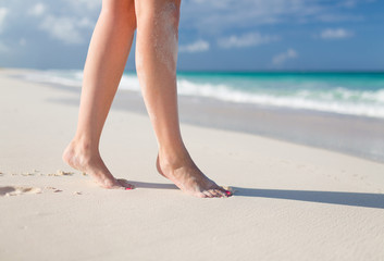 closeup of woman legs on sea shore