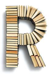 Letter R formed from the page ends of books