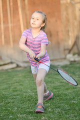 Cute little girl playing badminton