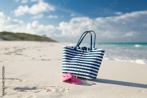 canvas print picture close up of beach bag and slippers at seaside