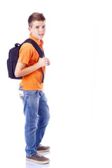 Full body portrait of a smiling school boy with backpack, isolat