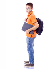 Portrait of a smiling school boy with backpack holding a noteboo