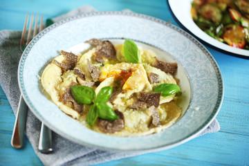 Ravioli pasta filled with ricotta, egg yolk and black truffles