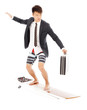 business man holding a briefcase and standing surfing board