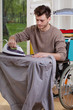 Disabled ironing shirts on board
