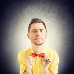 Confident nerd hipster young man with red bowtie