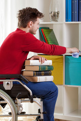 Disabled holding a book and wiped the dust