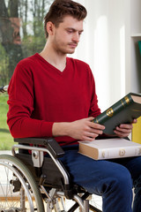 The young disabled looking of book
