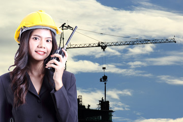 Engineer woman talking with a walkie talkie