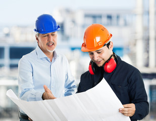 Engineer explaining a drawing