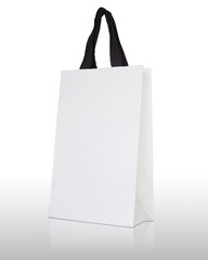 white paper bag on white background