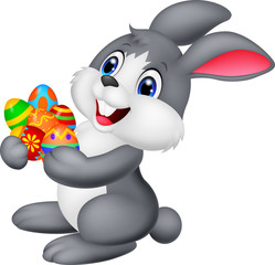 Cartoon bunny holding decorated egg