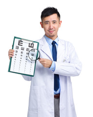 Doctor with eye chart and magnifying glass