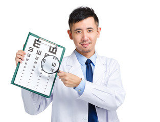 Doctor hold with eye chart and magnifying glass
