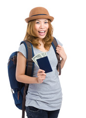 Happy woman with passort and cash