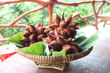 Fresh Salak snake fruit in basket.
