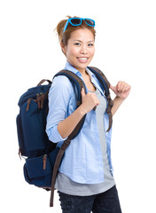 Woman with backpack and sunglasses