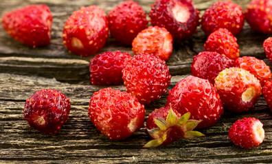 Strawberries on a background of the old board