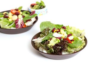 Plate with salad on white table