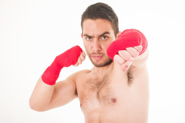 hispanic martial arts fighter wearing red shorts and wristband