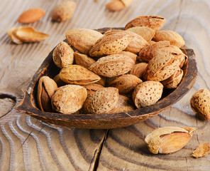 almond nuts on wooden table