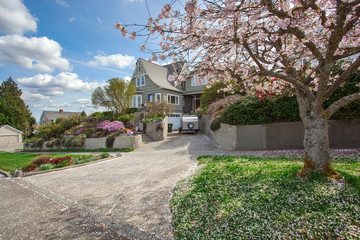 House exterior with blooming cherry tree