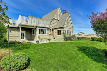 House exterior with walkout deck. Backyard view