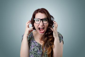Woman screaming in horror, grimace portrait
