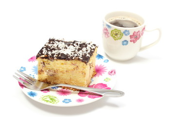 Delicious cheesecake on colorful plate and cup of coffee.