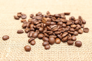 Heap of coffee on jute background