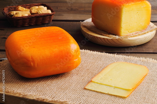 Traditional pieces of semi matured cheese - 67520075